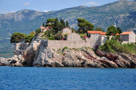 View from the sea to the island of Sveti Stefan, Montenegro.