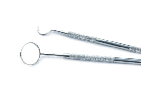 Dental tools isolated on a white background.