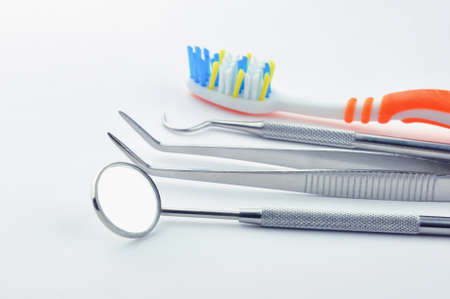 Dental tools on a gray background.