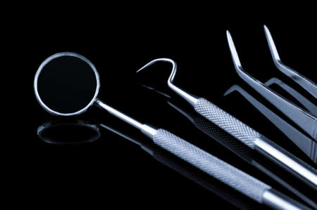 Dental tools with reflection on a black background. Stock Photo