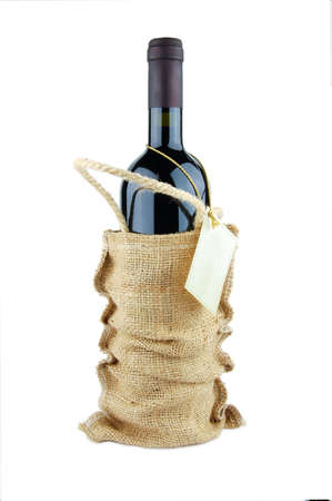 Wine bottle in bag isolated on white background