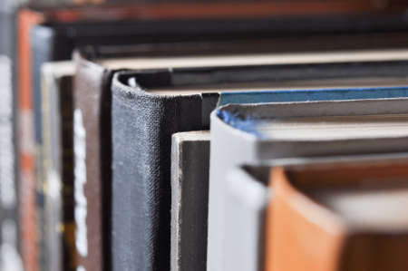 Various old books on a shelf. Closeup with shallow dof. Imagens