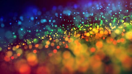 a cloud of multicolored particles in the air like sparkles on a dark background with a small depth of field. beautiful bokeh light effects with colored particles. background for holiday presentations Stock Photo