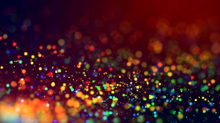 cloud of multicolored particles in the air like sparkles on a dark background with depth of field. beautiful bokeh light effects with colored particles. background for holiday presentations. Stock Photo