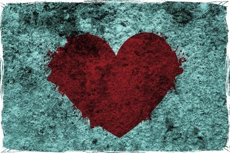 Grunge heart graffiti on the wall photo