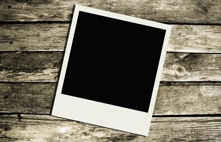 recollection: Polaroid over wooden texture