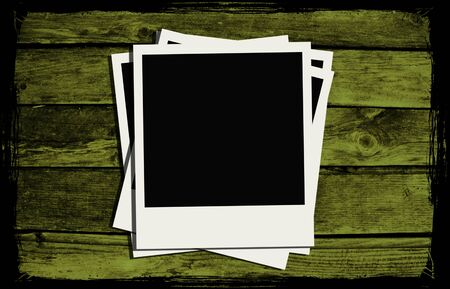 Polaroid frames over abstract wooden background photo