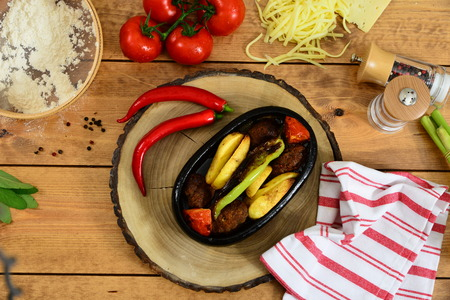 olla: Traditional Turkish food casserole and red paper, tomato Stock Photo