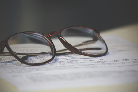 A sheet of paper and a pair of glasses Stock Photo - 76354759