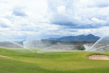 sprinkler: sprinklers on golf course at mae moh mine Stock Photo