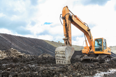 Backhoe and Coal Seam in open pit photo