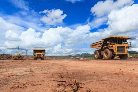 mud pit: big truck in open pit and blue sky at mae moh Mine