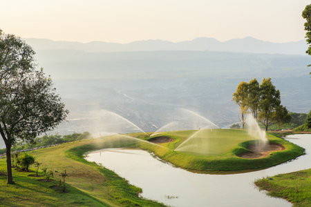 sprinklers: Golf  Course in Open Pit at Mae Mo Mine THAILAND Stock Photo