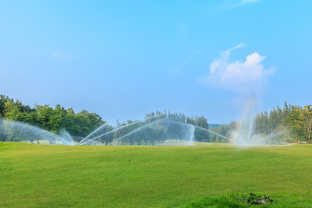 sprinklers on golf course at mae moh mine photo