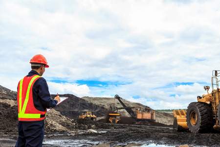 coal truck: Worker in lignite mine at north of THAILAND Stock Photo