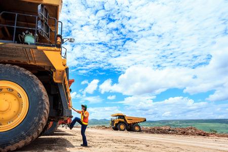 mining truck: Working Women Big Truck Driver in Open Pit