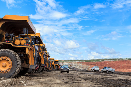 big truck in open pit and blue sky at mae moh Mine