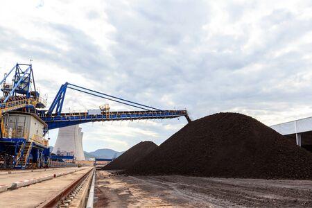 stockpile: Coal in Stockpile and Power Plant Stock Photo