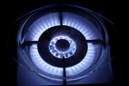water on burning blue blaze gas burner