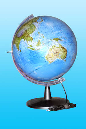steppe: globe for study of the geographies on turn blue background