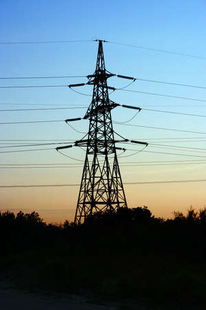 high-tension line electric wire on background of the sundown sky photo