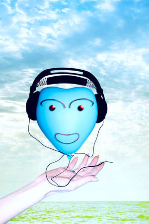 scene sound earphone in sulky ball with smile on him Stock Photo - 3030718