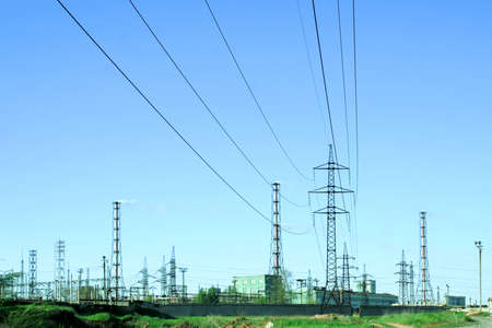high tension: high-tension wire and pipes of the enterprise on background blue sky Stock Photo