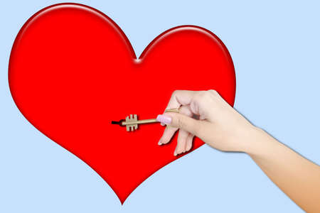 keeps: feminine hand keeps key Stock Photo
