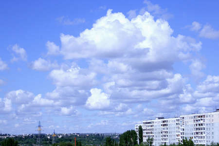 cloud on sky on apartment buildings of the city photo