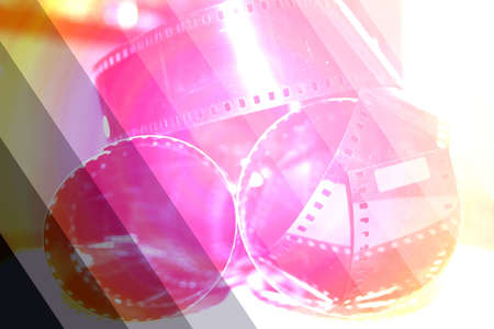 rolling up:  photographic negative film rolling up in spirals forms patterns Stock Photo