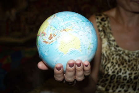 abstract scene globe in feminine hand photo