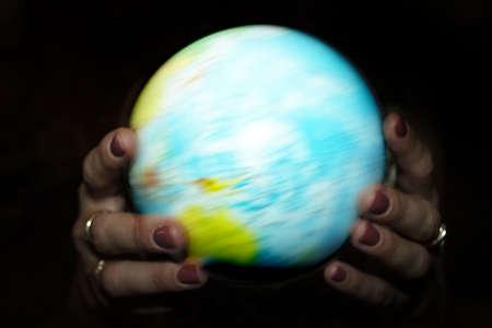 abstract scene globe in feminine hand photo