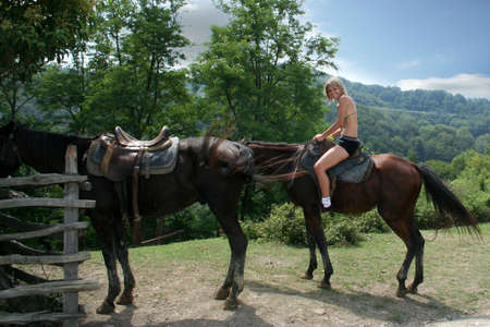 bosom: beautiful making look younger girl sits in saddle on horse