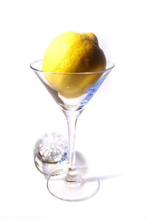 fresh lemon in glass liquor-glass photo
