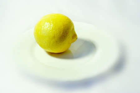 blanching plate with rest yellow lemon upon her photo