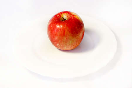 blanching plate with rest red apple upon her photo