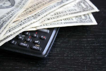 paper dollar bills resting upon dark background Banque d'images