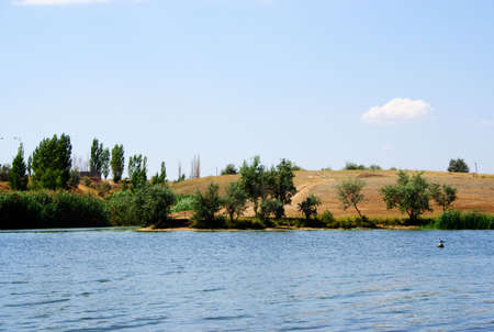 autumn landscape with calm rural river photo