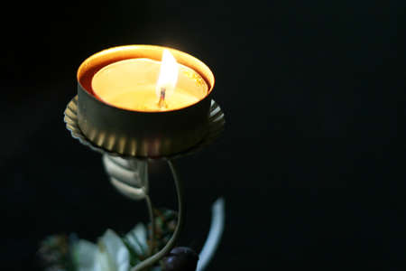 perforation: solitary burning candle