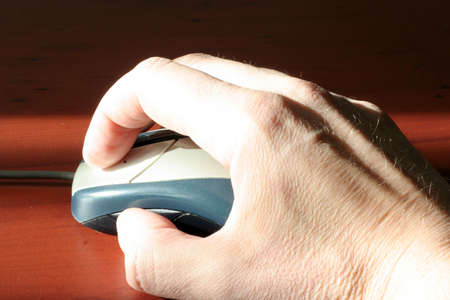 gentile: computer mouse in hand