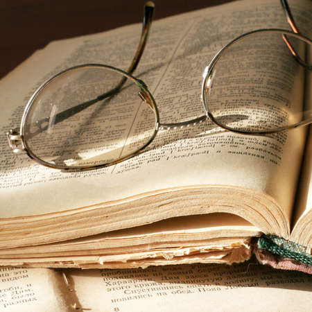 cogitations: pages aging book and spectacles for correcting the vision Stock Photo