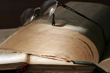 wit: pages aging book and spectacles for correcting the vision Stock Photo