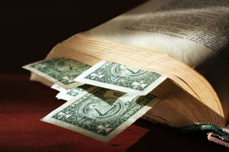 cogitations: abstract scene with old paper bills and aging book