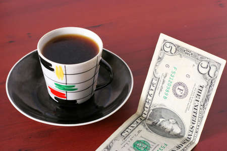 payment by cash for cup of the hot drink Stock Photo - 3856947