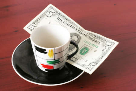 payment by cash for cup of the hot drink Stock Photo - 3856943