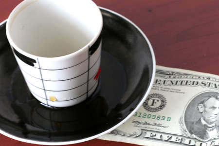 payment by cash for cup of the hot drink Stock Photo - 3856933