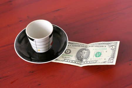 payment by cash for cup of the hot drink Stock Photo - 3856935