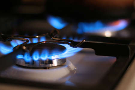 brightly burning natural gas on kitchen photo