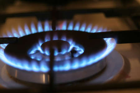 stove pipe: brightly burning natural gas on kitchen Stock Photo