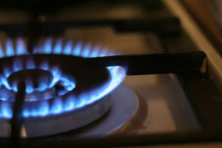 brightly burning natural gas on kitchen Stock Photo